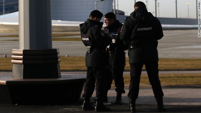 Security personnel look talk in the Olympic Park in the Coastal Cluster on January 9, 2014 in Alder, Russia.