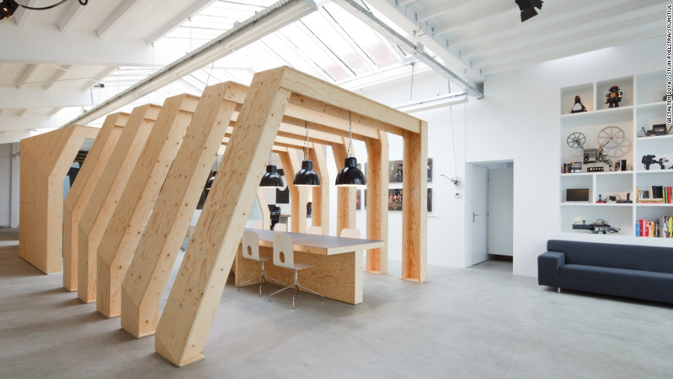 "<a href=""http://www.onesize.nl/"" target=""_blank"">OneSize</a>, a motion graphics firm in Amsterdam, have created a series of contrasts within their 300 sq. m office. The exterior is essentially a sleek white box. Inside, however, a series of raw wooden ribs are used to create an open conference room. Enclosed wooden spaces are also available for more private employees."