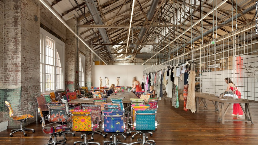 The derelict warehouses that comprise Urban Outfitters corporate campus dovetail nicely with the brand's kooky fashion sense. Indoor walkways are lined with ponds and flowers to offset the industrial feel, and brightly-patterned chairs pop amid the gritty surroundings.