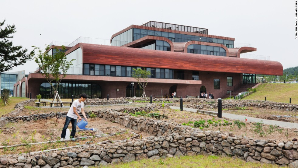 "In 2012 Korean IT firm <a href=""http://www.daum.net/"" target=""_blank"">Daum</a> relocated to an island off the coast of Korea. Its earth-toned office reflects the firm's stated commitment to building community through nature. The grounds include a communal garden and outdoor play space for the firm's day care center."
