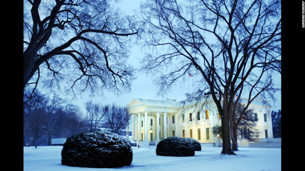 Dusk falls over a snow-covered White House in Washington on January 21.