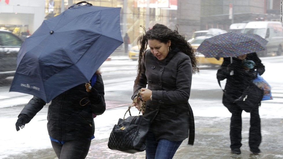 People brave the elements in New York's Times Square on January 21.