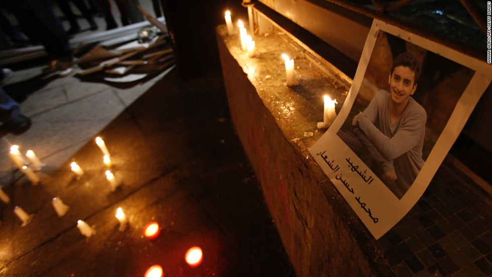 A portrait of Mohammad al-Chaar is seen during a candlelight vigil at the site of the blast. The car bombs haven't stopped since his death.