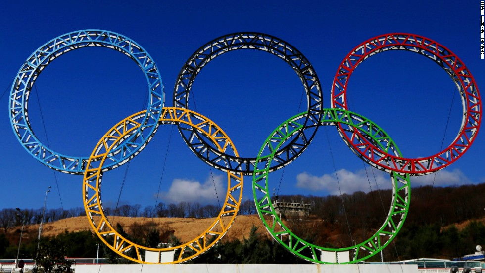 The Olympic rings light up the sky outside Sochi International Airport. An estimated 3 billion people are expected to watch the Olympics on television.