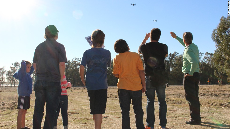 "Drone hobbyists watch a pair of the aircraft take to the air at a recent Make Drone ""Fly-In"" event in American Canyon, California. Click through for more scenes of drones and their human masters."
