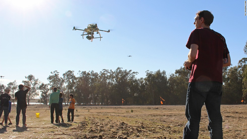 An enthusiast takes a drone, outfitted with a camera, for a spin in the test flight area. Aerial photography is one of the most popular uses for smaller consumer drones.