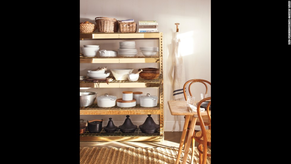 "Basic, utilitarian wire shelves get a glamorous makeover with brass plating. ""What was once an inexpensive shelving unit is now a gorgeous heirloom,"" says Kevin Sharkey, executive director for decorating for Martha Stewart Living. ""You can refinish any metal with brass, except for aluminum,"" says Jeff Higdon, owner of Victoria Plating, who custom-plated these shelves."