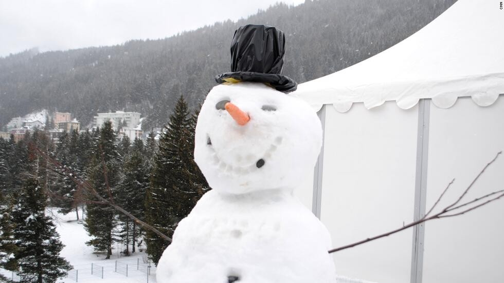 The traditional World Economic Forum snowman stands guard outside CNN's live position.
