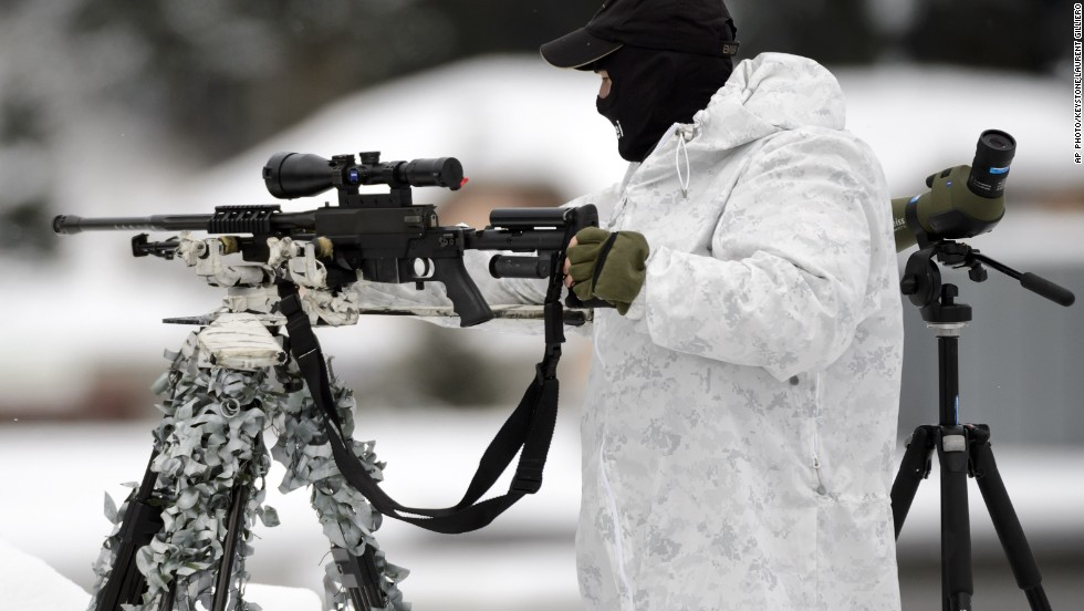 Security is key in Davos, with more than 40 heads of state attending. Pictured here is a Swiss special police sniper on the roof of the Congress Center.