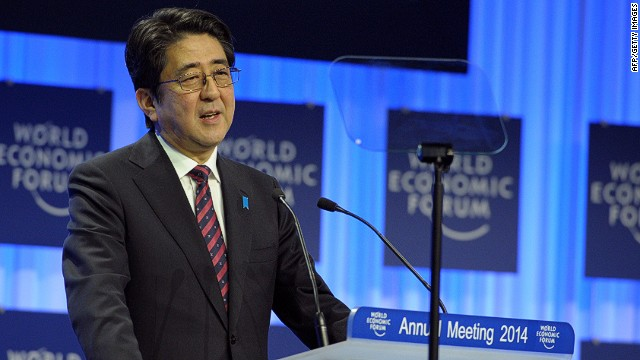 """Japanese Prime Minister Shinzo Abe delivers his special address during the opening session of the World Economic Forum in Davos on January 22, 2014. Top bosses and economists warned the global elite not to get over-excited by a gradual economic upturn in Europe, which one chief executive branded an """"emerging country."""" AFP PHOTO/ERIC PIERMONTERIC PIERMONT/AFP/Getty Images"""