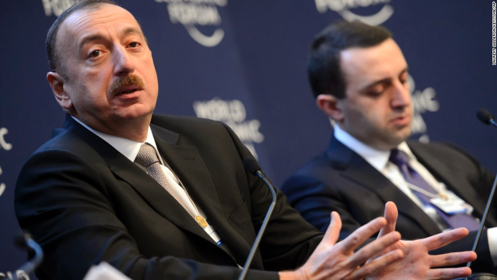 Ilham Aliyev, left, President of Azerbaijan, speaks next to Irakli Garibashvili, right, Prime Minister of Georgia, during a panel session on the second day of the meeting.