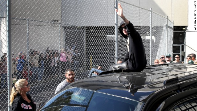 MIAMI, FL - JANUARY 23:  Justin Bieber waves after exiting from the Turner Guilford Knight Correctional Center on January 23, 2014 in Miami, Florida. Justin Bieber was charged with drunken driving, resisting arrest and driving without a valid license after Miami Beach police found the pop star street racing Thursday morning.  (Photo by Joe Raedle/Getty Images)