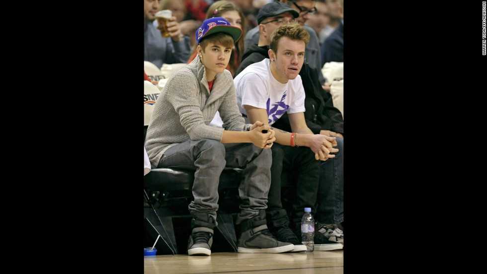"Even as he's become astronomically famous, Bieber hasn't lost touch with his Canadian childhood friends. Ryan Butler (pictured right in 2011) is a familiar face to Beliebers both on and off the red carpet, and he considers Bieber a brother. On Twitter, you'll often catch him offering Bieber supportive tweets <a href=""https://twitter.com/itsRyanButler/status/408328997294989314"" target=""_blank"">like this one</a>."