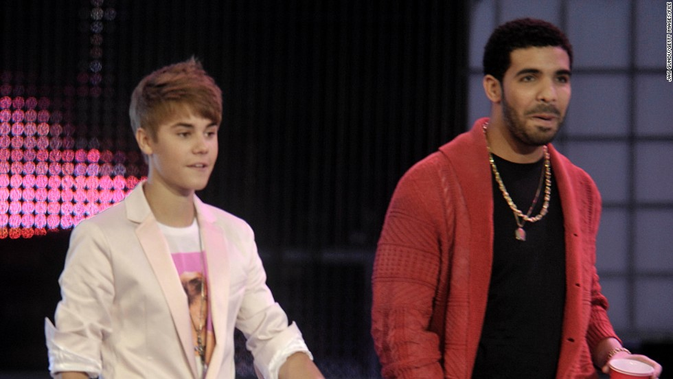 "Drake, seen here with Bieber in 2011, is another star who's taken the young singer under his wing. According to Braun, Drake is one of the first people to rip into Bieber after spotting a tawdry headline about him in the news. ""He'll text me, like, 'What the hell is going with this? I'm pissed. I'm calling him right now. I'm about to go in on him,' "" <a href=""http://www.hollywoodreporter.com/news/justin-bieber-reveals-will-smith-657535"" target=""_blank"">Braun told THR</a> in 2013."