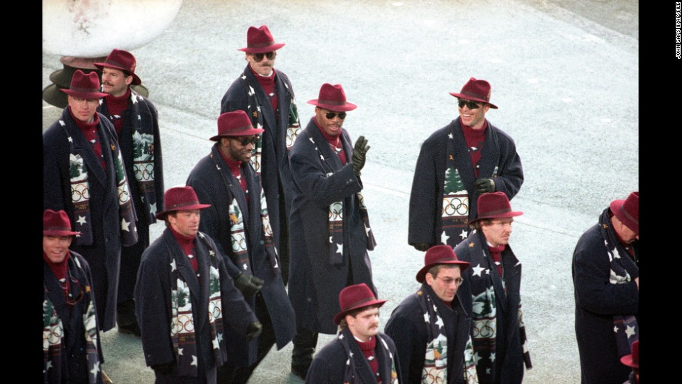 The Americans at the 1992 Winter Olympics in Albertville, France. Here, U.S. bobsled team member Herschel Walker, famous as a football player, waves to the crowd during the opening ceremony.