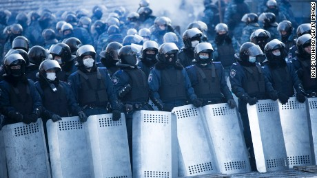 Riot police stand guard near Dynamo Stadium in Kiev on January 24.