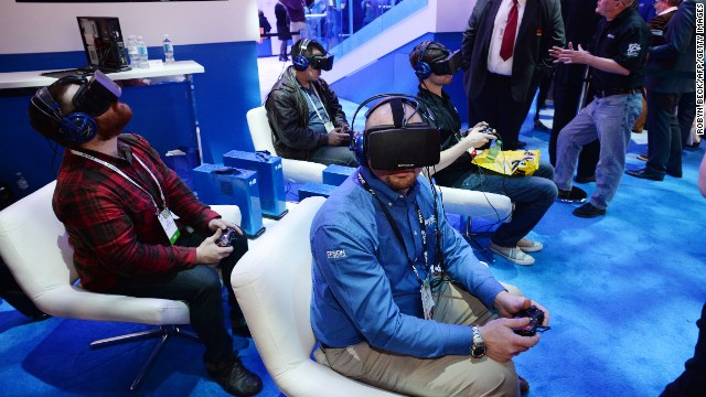 Attendees wear Oculus Rift virtual-reality headsets as they play a virtual-reality shooter game at CES this month in Las Vegas.