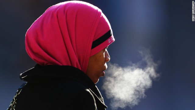 A woman exhales in the freezing temperatures of Philadelphia on Thursday, January 23.