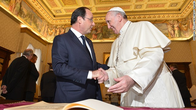 French President Francois Hollande, left, meets with Pope Francis on Friday at the Vatican.