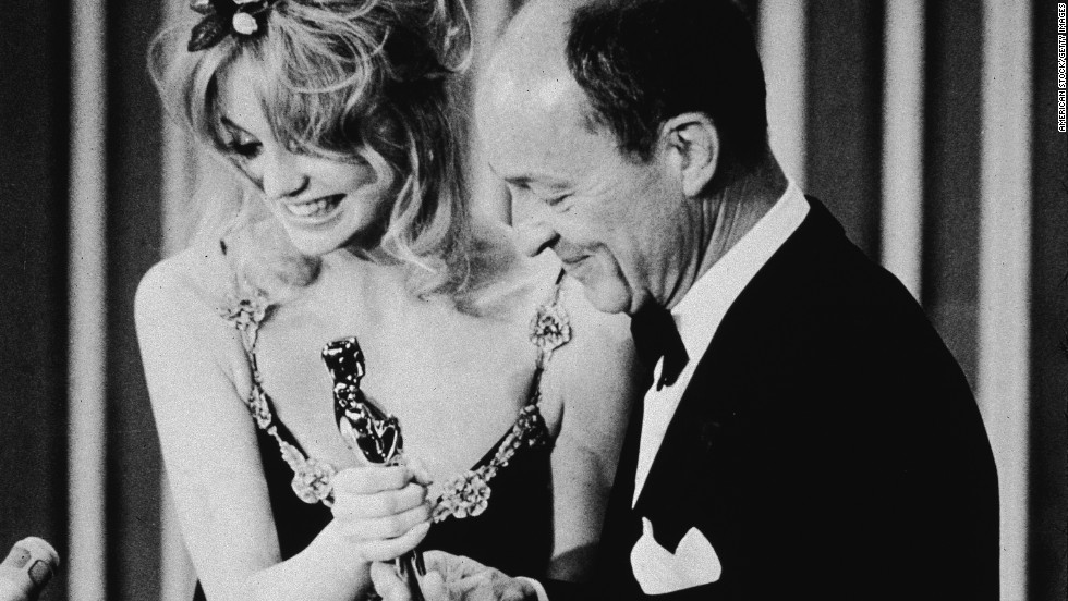 "American actor Goldie Hawn presents the Best Actor Oscar to Frank McCarthy, accepting on behalf of George C. Scott for his role in the film, ""Patton,"" in April 1971."