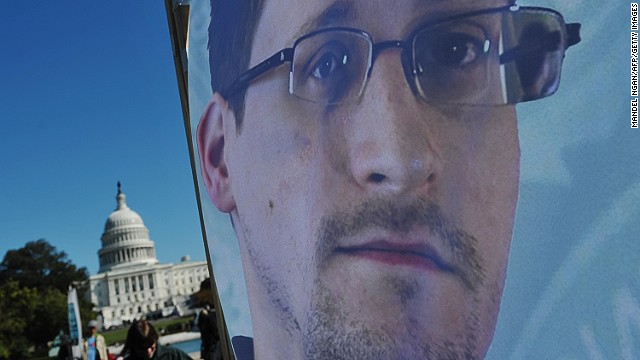 An image of Edward Snowden on a banner is seen in front of the US Capitol on October 26, 2013 in Washington, DC.