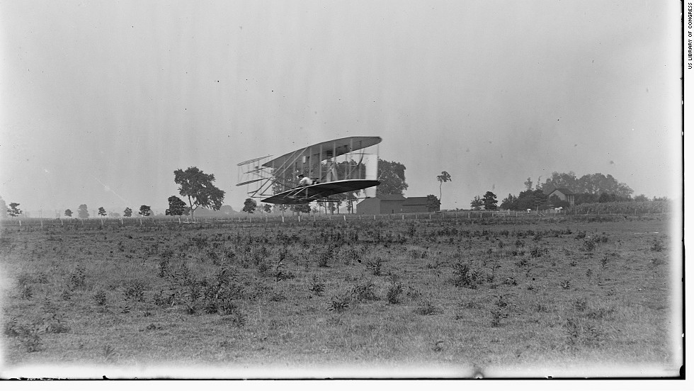 "In this photo from around 1904, Orville Wright pilots an aircraft across Ohio's Huffman Prairie Flying Field, covering a distance of 356 feet. After making history at Kitty Hawk, North Carolina, the Wrights developed ""a practical and usable machine"" in this pasture, said U.S. Park Ranger Robert Petersen. ""This is the Holy Grail. This is literally where aviation gets its start."" The landowner asked the Wrights to move any horses and cows out of the way before doing any flying, Petersen said. ""Sometimes there were issues."""