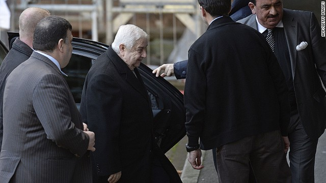 "Syria's Foreign Minister and head of the Syrian government delegation Walid Muallem (C) arrives at the UN headquarter to meet UN-Arab League envoy for Syria on January 24, 2014, on the ""Geneva II"" peace talks in Geneva. Syria's warring sides will not sit in the same room for the start of talks in Geneva Friday despite efforts by UN mediator Lakhdar Brahimi to bring them together, officials said. Brahimi spent Thursday in separate closed-door meetings with delegations from President Bashar al-Assad's regime and the opposition, trying to convince them to come together for their first talks since the start of Syria's civil war. AFP PHOTO / PHILIPPE DESMAZESPHILIPPE DESMAZES/AFP/Getty Images"