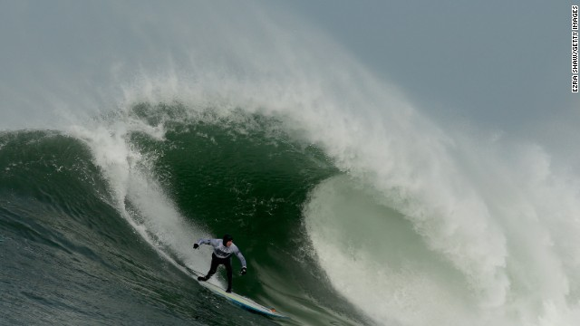 HALF MOON BAY, CA - JANUARY 24: Grant Washburn rides a wave during the second heat of round one of Mavericks Invitational on January 24, 2014 in Half Moon Bay, California. (Photo by Ezra Shaw/Getty Images)