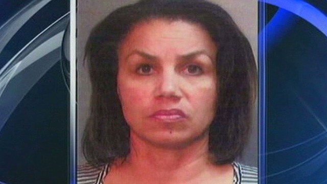 Teacher charged with pot poisoning