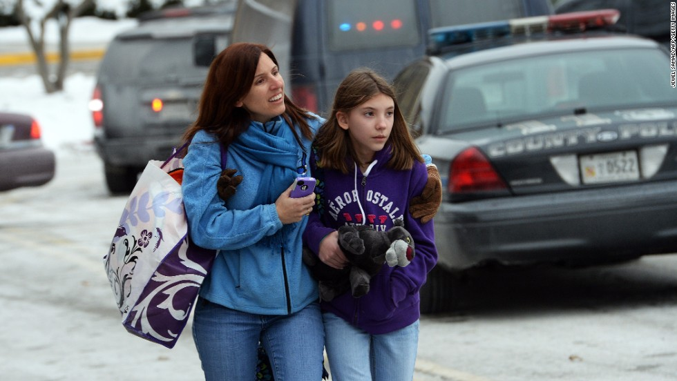 Two shoppers leave the mall after the shooting.