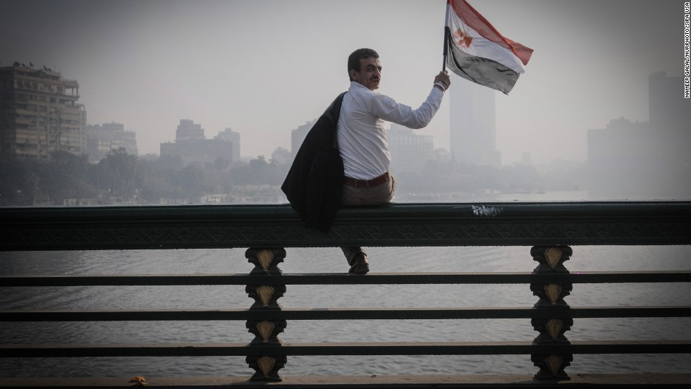 A man waves an Egyptian flag during a rally.