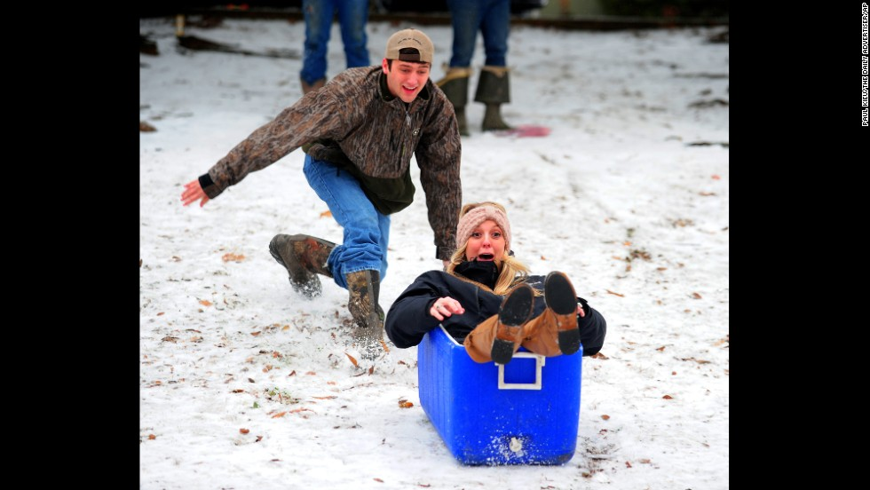 Ben Eggart pushes Hannah Graham down a hill at Girard Park in Lafayette, Louisiana, on January 24.