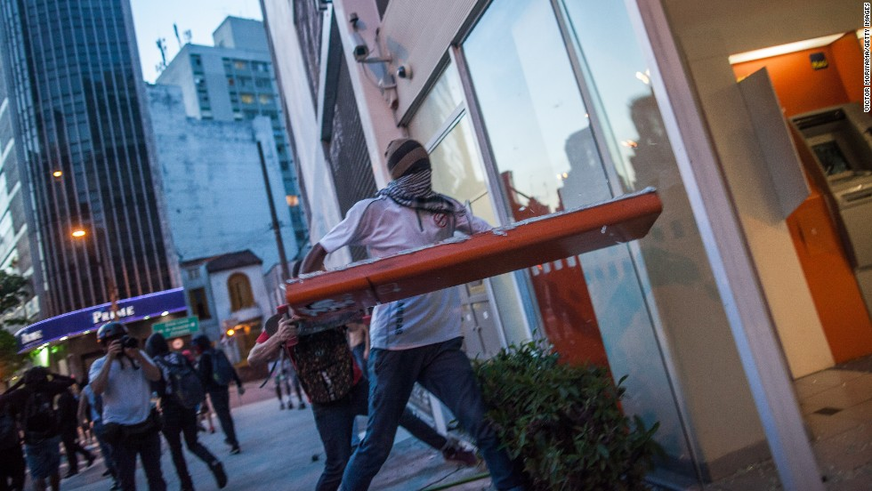 Protesters break the windows of a bank during demonstrations on January 25.