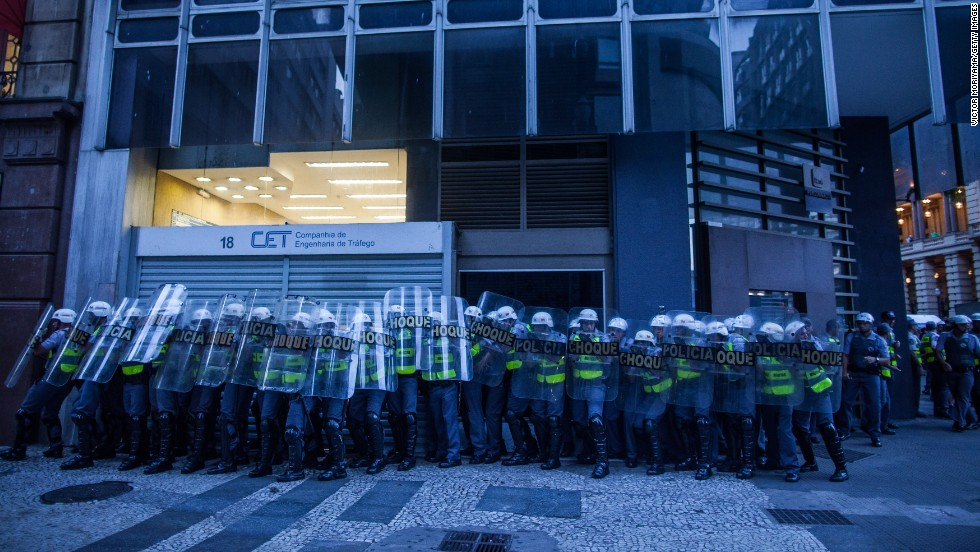 Police guard a bank during demonstrations.