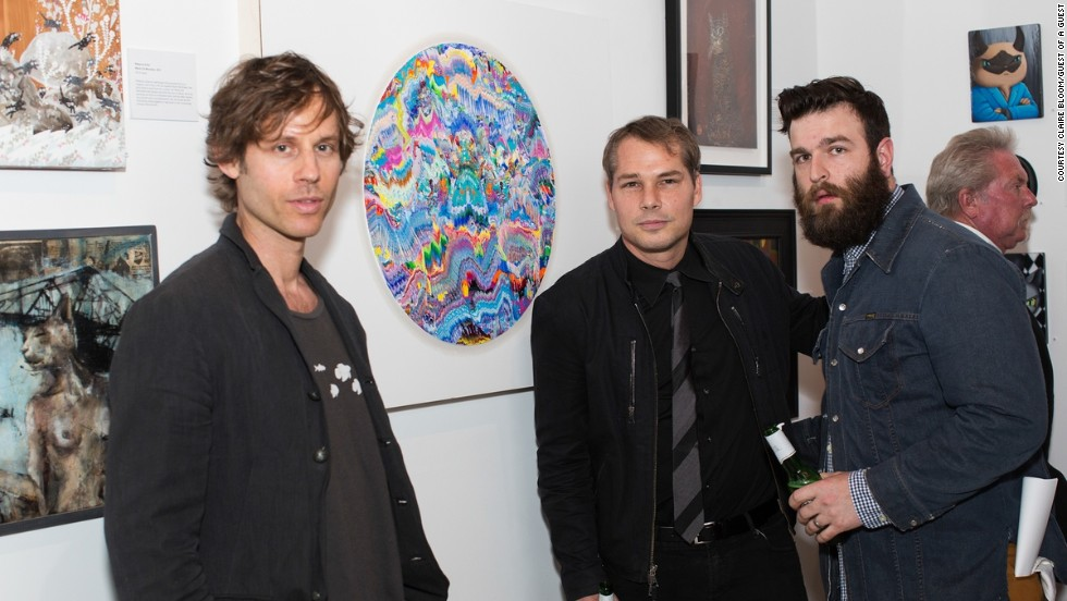 From left, artists Robert Standish, Shepard Fairey and Nicholas Bowers are seen at the show January 25.