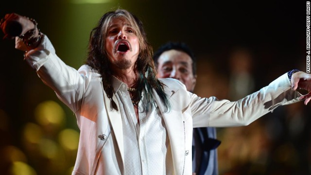 The lead singer of the rock group Aerosmith Steven Tyler performs on stage for the 56th Grammy Awards at the Staples Center in Los Angeles, California, January 26, 2014. AFP PHOTO FREDERIC J. BROWN        (Photo credit should read FREDERIC J. BROWN/AFP/Getty Images)