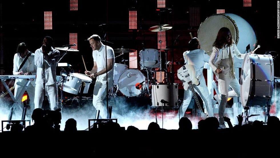 Part of the majesty of Kendrick Lamar's performance with Imagine Dragons during the 56th Grammys was the stark contrast of their all-white outfits against the set. Lamar and the band were ready and willing to stand out -- and they did.