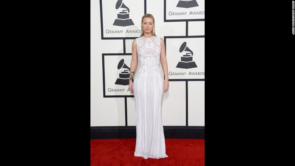 "Iggy Azalea was a class act in this all-white gown a the Grammy Awards. Subtle, but also sexy. We give it an ""A."""