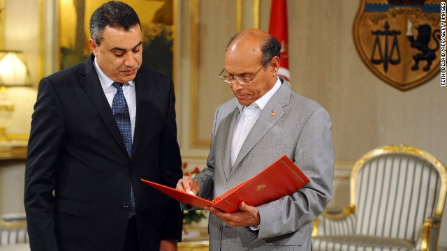 Tunisian President Moncef Marzouki (R) receives the list of members of the proposed government from premier-designate Mehdi Jomaa (L) during the new government presentation ceremony on January 26, 2014 in Carthage Palace in Tunis. Jomaa has presented the president with the list of his proposed cabinet of independents, under a roadmap aimed at ending months of political crisis. AFP PHOTO/FETHI BELAID (Photo credit should read FETHI BELAID/AFP/Getty Images)