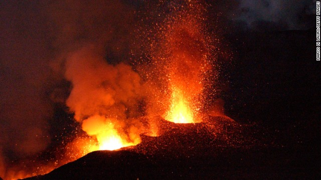 Mount Etna, Europe's most active volcano, explodes spilling lava down the mountain sides and shooting ash into the sky October 30, 2002 near the town of Nicolosi, near Catania, Italy.