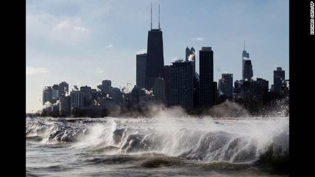 Ice forms as waves crash along the Lake Michigan shore in Chicago on Monday, January 27.