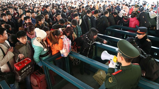 BEIJING, CHINA - JANUARY 26: (CHINA OUT) Passengers wait for trains at Beijing West Railway Station on January 26, 2014 in Beijing, China. The Chinese Spring Festival travel rush began on January 16 and about 3.62 billion passenger trips are expected to be made across the country, with around 257 million train trips during the 40-day lunar New Year travel period. (Photo by ChinaFotoPress/Getty Images)