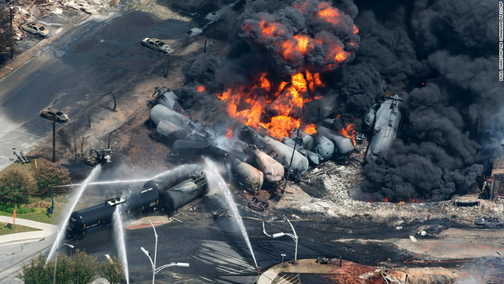 Smoke rises from railway cars after a train derailed in Lac-Megantic, Quebec, Canada, on July 6, 2013. A large swath of Lac-Megantic was destroyed after the derailment sparked several explosions. The train was carrying crude oil. At least 42 of the community's 6,000 residents died.