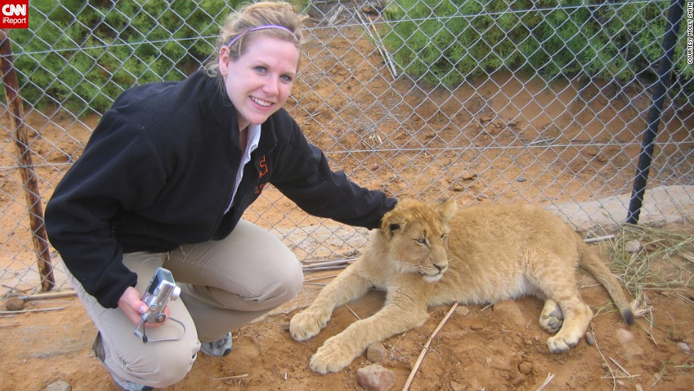 She wants to travel. Smith traveled to Europe and Africa with her college choir. Here she is petting a lion cub at an animal reserve outside of Cape Town, South Africa, in 2005. She'd like to go to Australia to visit her pen pal of 15 years, too.