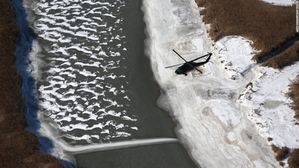 A Black Hawk helicopter flies near MetLife Stadium on January 28. Customs and Border Protection agents are helping to secure the area for the Super Bowl.
