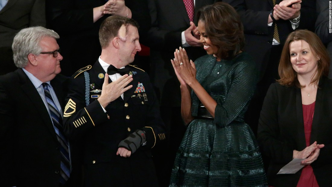 "Obama wore <a href=""http://www.huffingtonpost.com/2014/01/28/michelle-obama-state-of-the-union-dress-2014_n_4676593.html"" target=""_blank"">this forest green Azzedine Alaia ensemble</a> -- which included a full-skirted dress, an oversized belt and a cropped jacket -- for the State of the Union address on January 28, 2014."