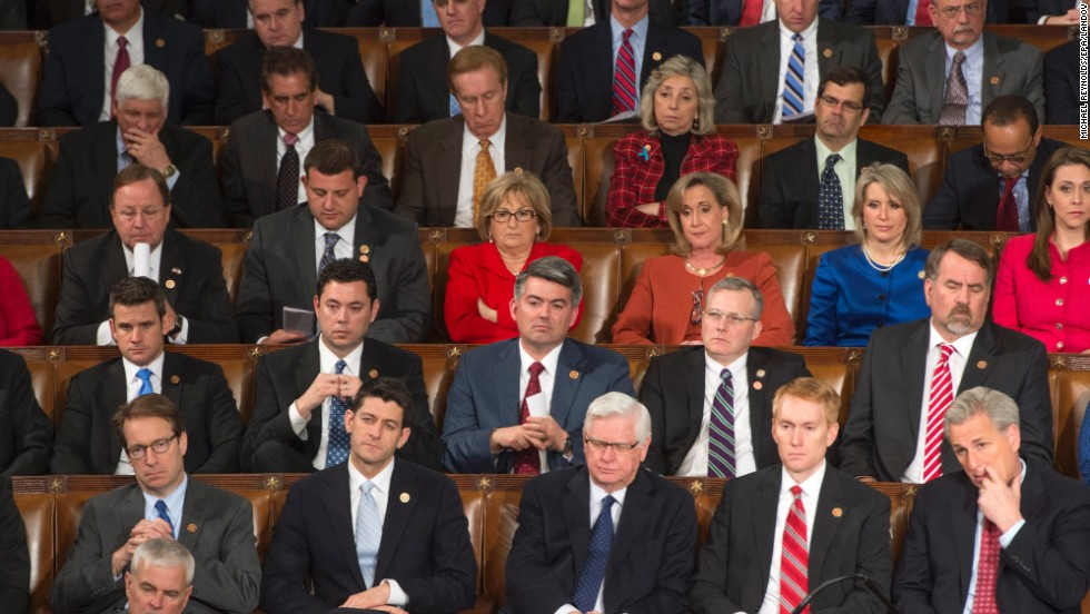 Republican senators and representatives listen to President Barack Obama's speech during the State of the Union.