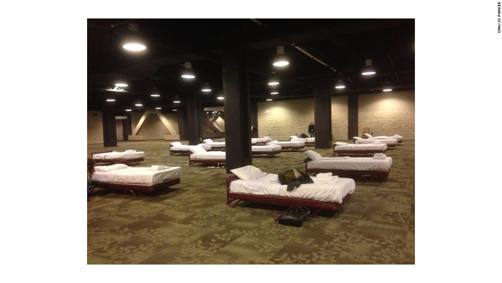 """CNN Video Producer <a href=""""http://ireport.cnn.com/docs/DOC-1079327"""">Jo Parker</a> slept alongside other female staffers in the basement of the Omni Hotel in Atlanta, where all rooms were booked. Male CNN staffers had less luxurious accommodations in the employee gym."""