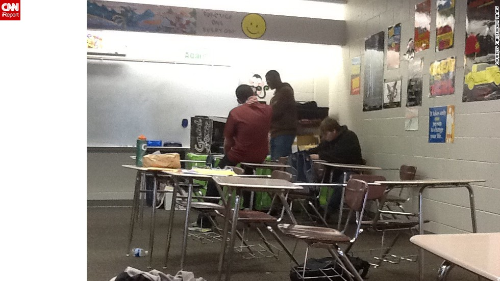 "The severe weather forced 4,500 students to spend the night in various school buildings in Hoover, Alabama. High school student <a href=""http://ireport.cnn.com/docs/DOC-1079057"">Christopher Brady</a> shot this photo Tuesday evening. ""At first we were excited, but then we panicked a bit,"" he said."