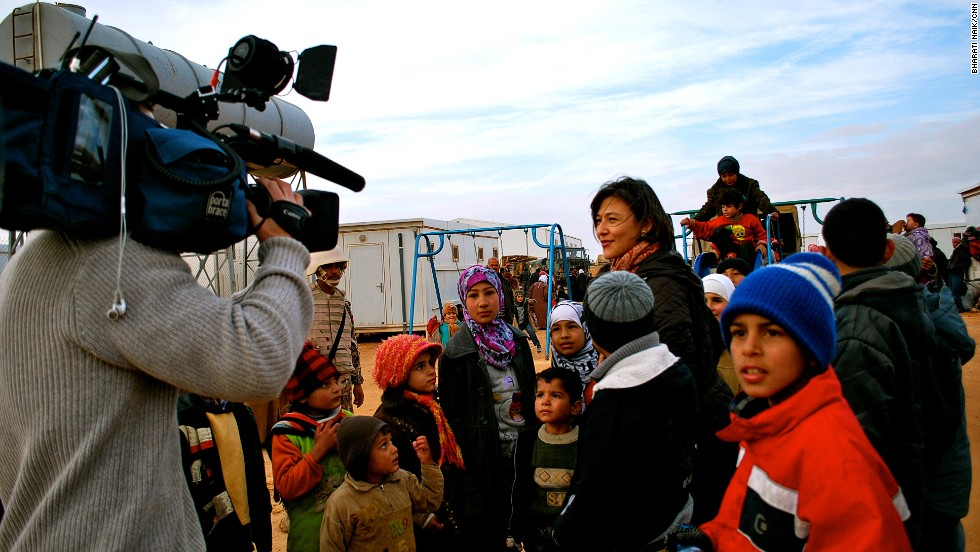 Children arriving at the base camp were overjoyed to see a playground, but after registering as refugees they still face a 400 kilometer drive to the Zaatari refugee camp.